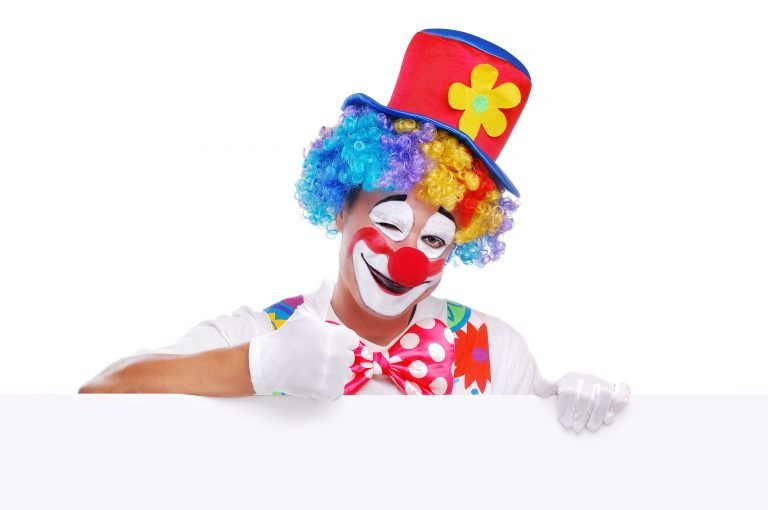 Clown entertainer with a thumb up for Rico Kids New Website